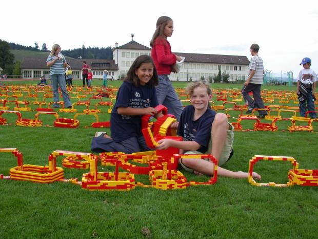 Picture Source: LEGO (http://aboutus.lego.com/en-us/news-room/2003/september/700-swiss-children-build-the-longest-lego-chain)