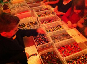 The kids had thousands of LEGO to help decorate their gingerbread houses.