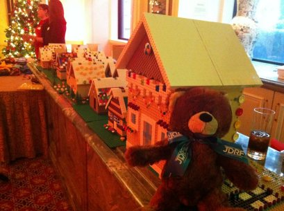 Even the JDRF Teddy Bear has stopped by the Gingerbread Castle to hang out at the LEGO Village.